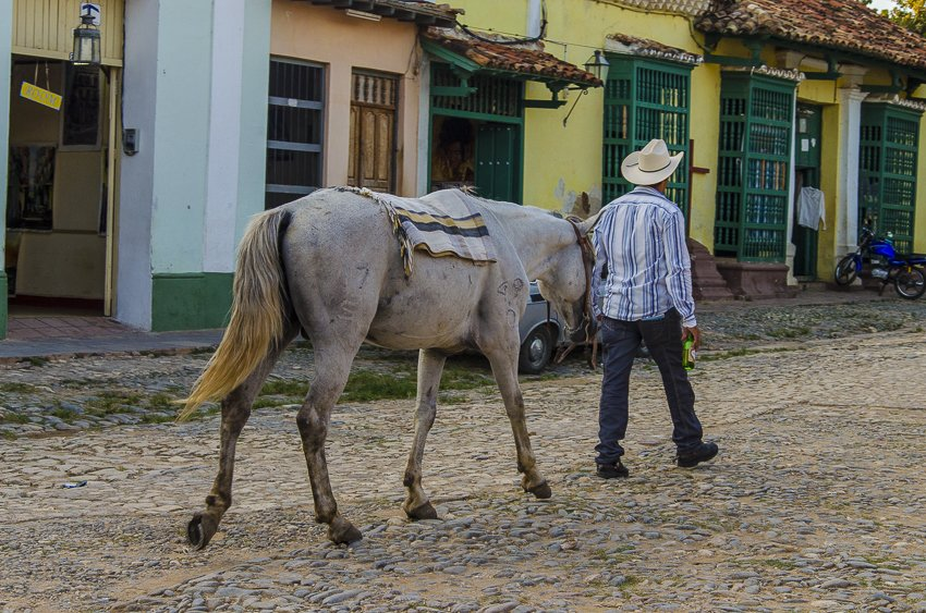 Cowboy walkign his horse home, Trinidad - people