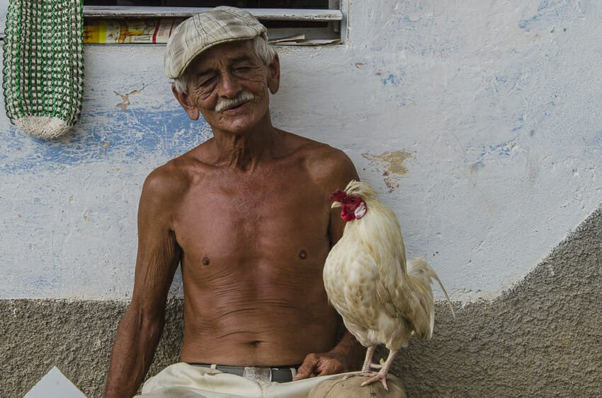 Man and his chicken, Trinidad - people