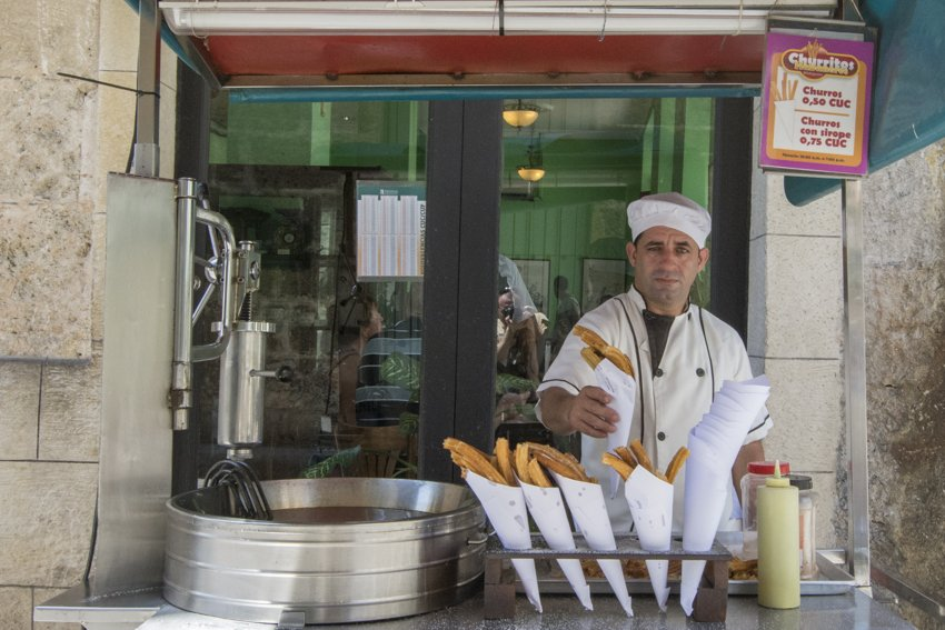 Delicious churros in Havana - people