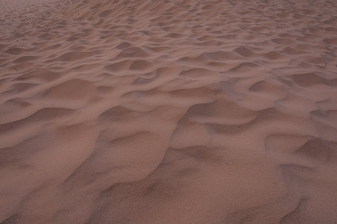 Walking on sand at Burrah Canyon